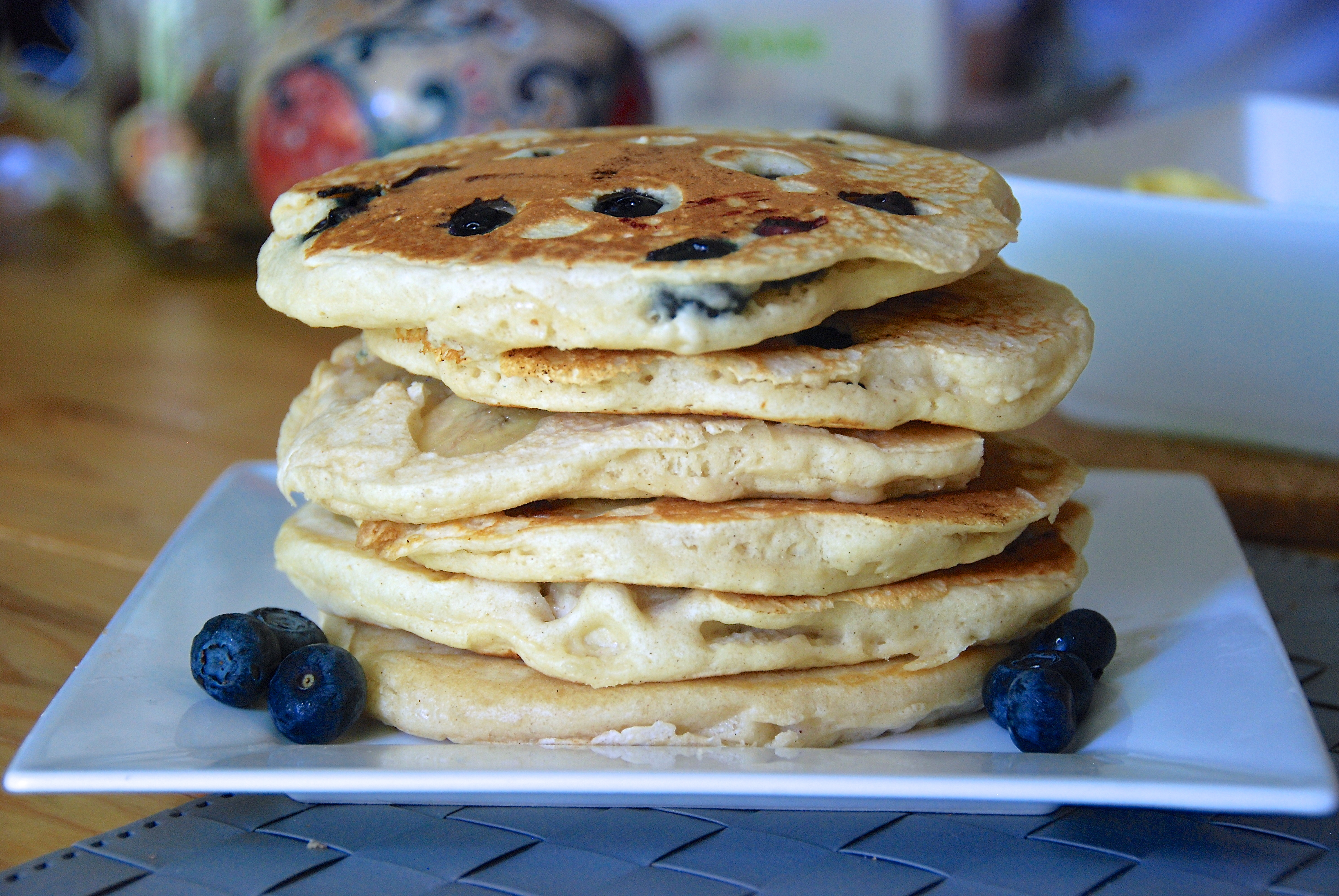 Homemade banana and blueberry pancakes. - Two Red Bowls