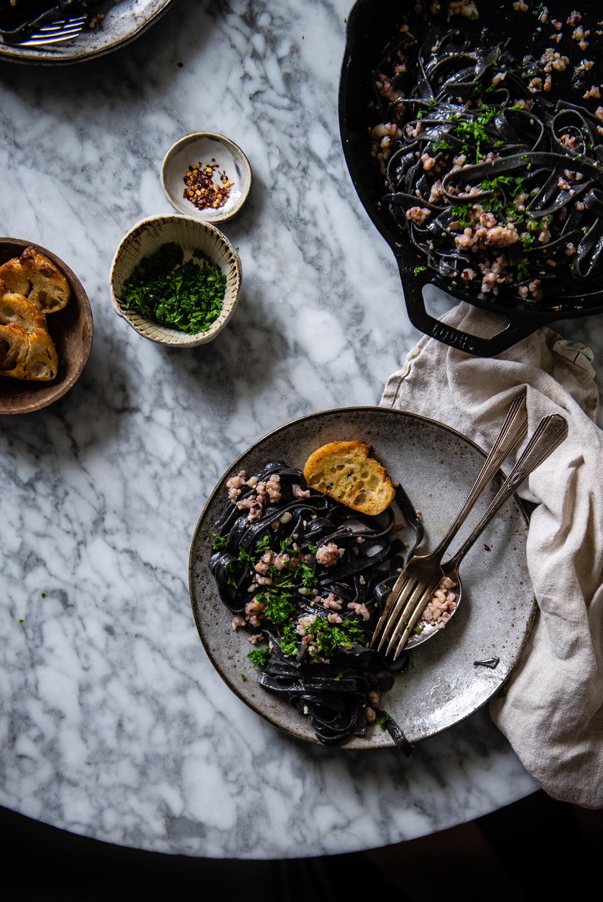 squid ink pasta aglio e olio - Two Red Bowls