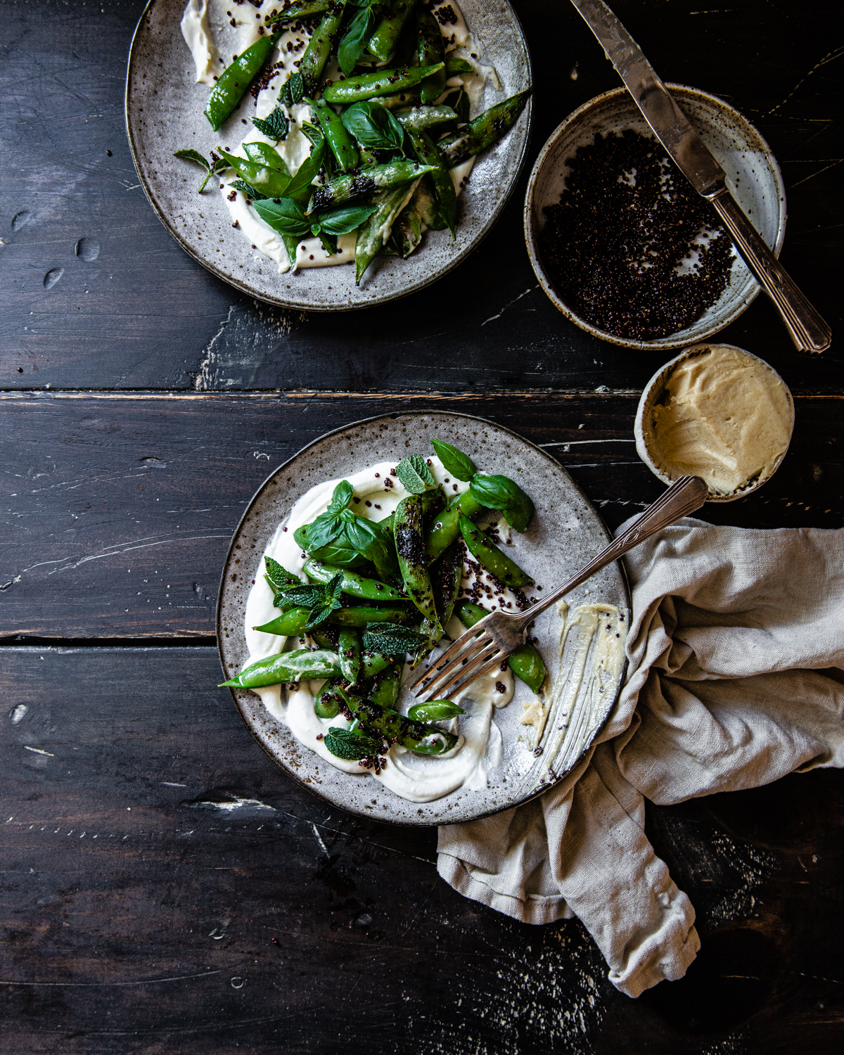 blistered sugar snaps with crispy quinoa, miso honey butter, and whipped feta